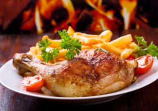 roasted chicken leg with fries potato and herbs